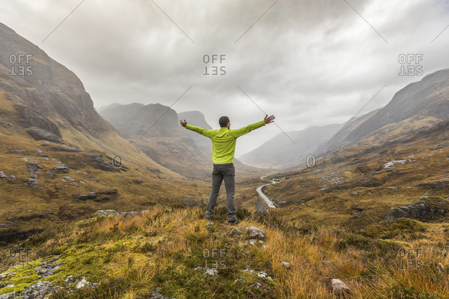 UK- Scotland- man in the Scottish highlands near Glencoe with a view on the Three Sisters