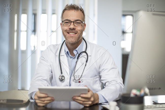 Portrait of smiling doctor in medical practice