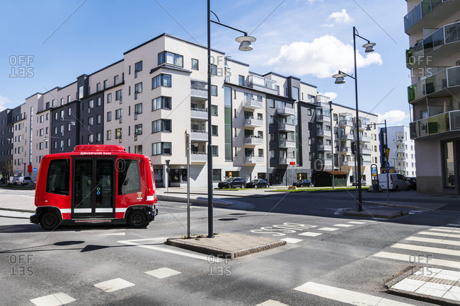 May 16, 2020: Bus on road, blocks of flats on background
