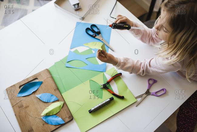 Girl making paper craft - Offset