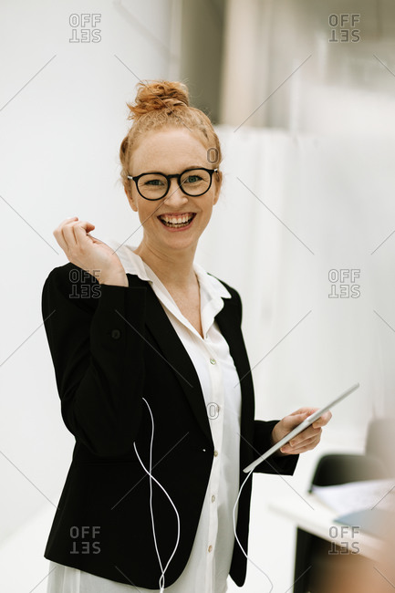 Woman holding digital tablet in office