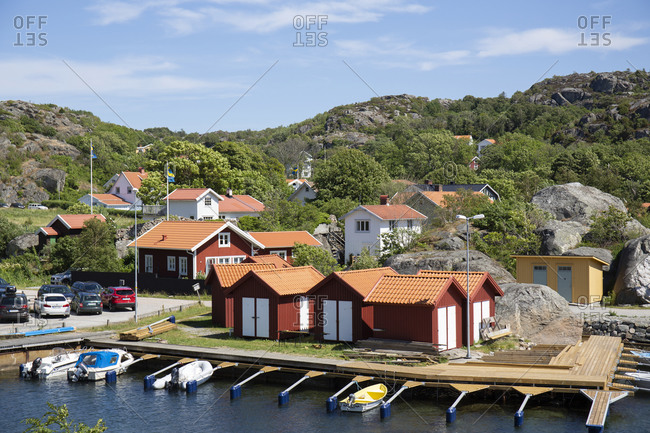 June 23, 2018: Coastal landscape with houses and moored boats