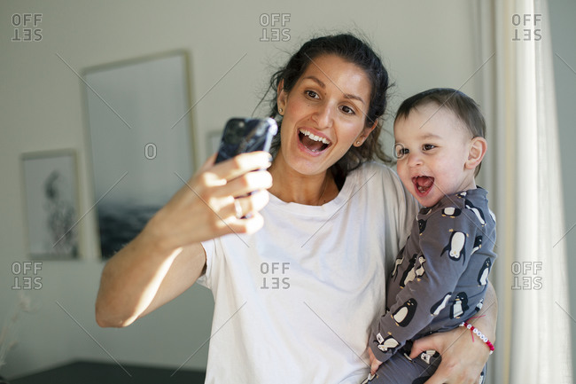 Mother taking selfie with toddler son