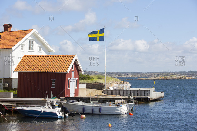 View of coast with Swedish flag