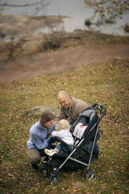 Parents with toddler sitting in pram