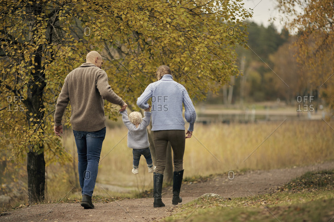 Parents with toddler having walk
