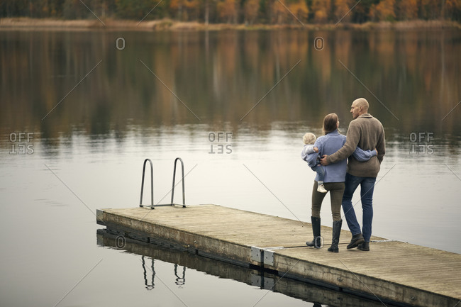 Parents with toddler on jetty