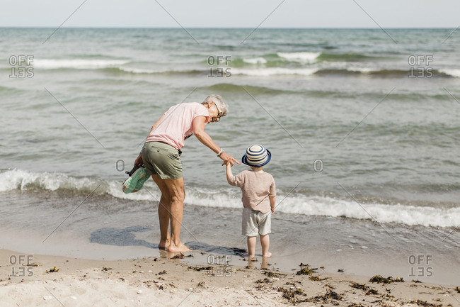 Grandmother with grandson at sea