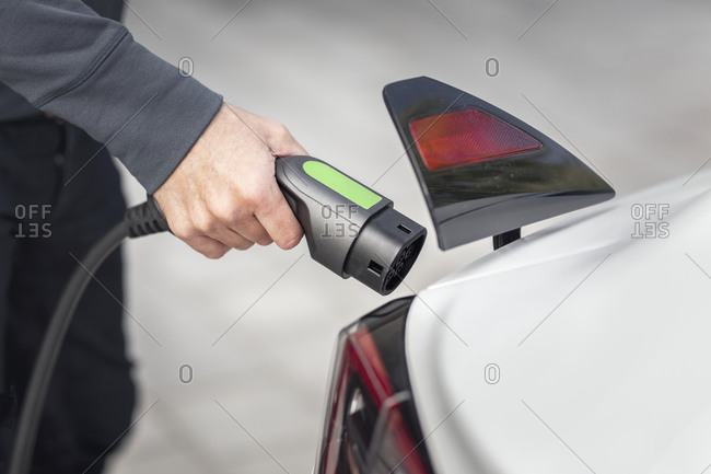 Mans hand holding car charger