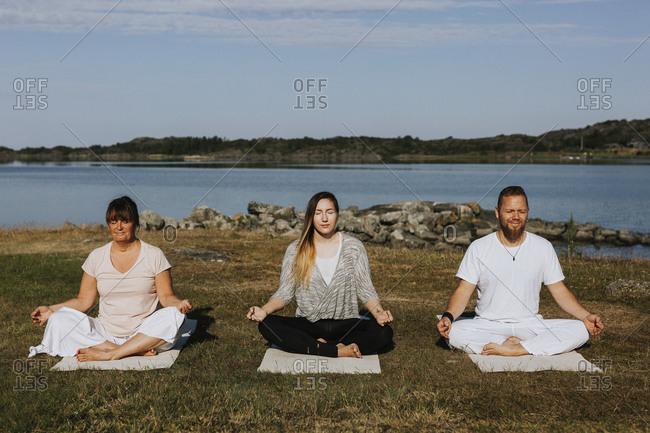 People meditating at sea
