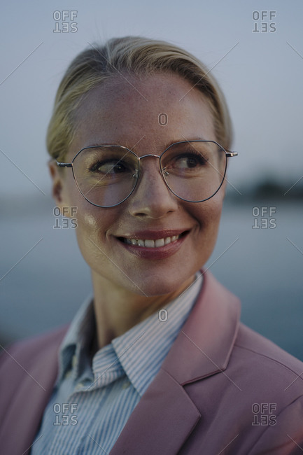 Close-up of smiling beautiful female professional looking away at dusk