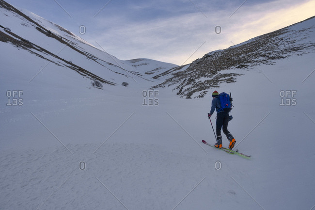 Young man cross-country skiing on Sibillini mountain at sunset- Umbrian- Italy