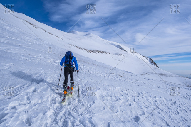 Man cross-country skiing on Sibillini mountain against sky- Umbrian- Italy