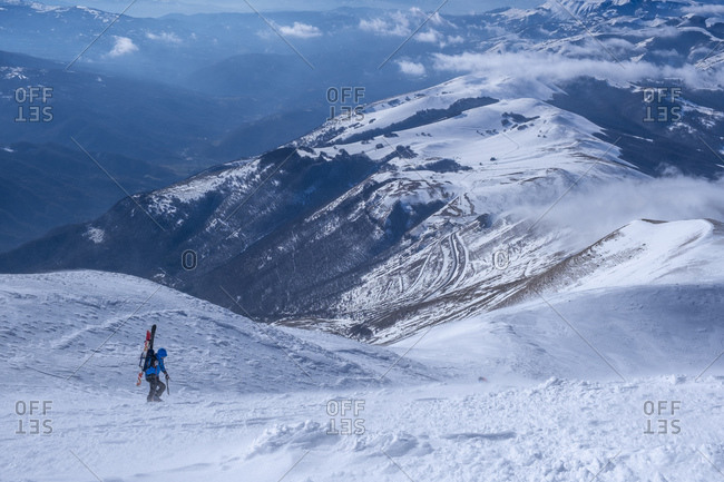 Man cross-country skiing on Mount Vettore in Umbrian- Italy