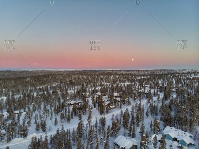 Finland- Lapland- Saariselka- Aerial view of snow-covered mountain village at dusk