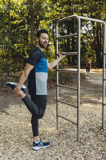 Man stretching on fitness trail