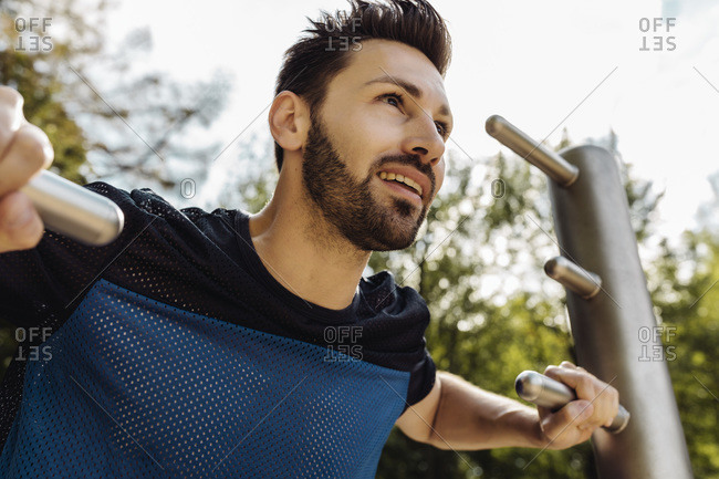 Portrait of man stretching on a fitness trail
