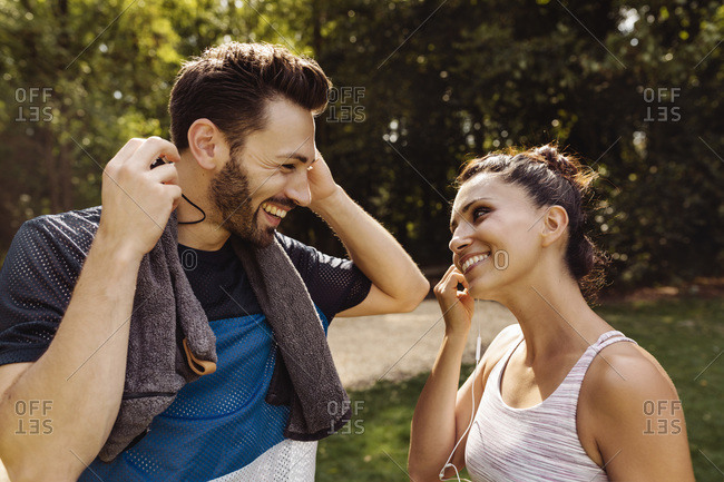 Sporty man and woman talking in a park