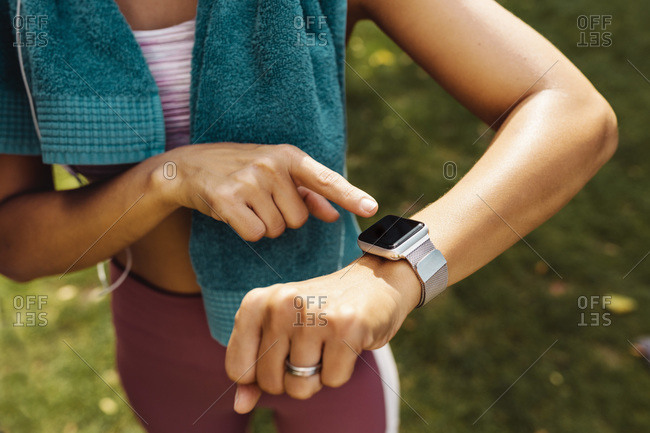 Sporty woman's arm with smartwatch