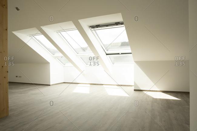 Sunlight falling through windows on floor in new house