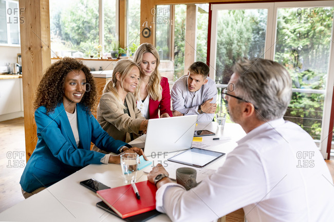 Business people discussing strategy at desk in office