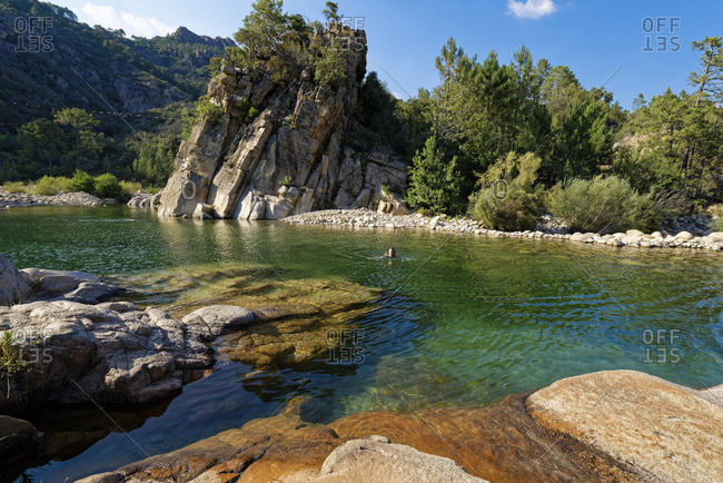 Woman swimming in Solenzara river
