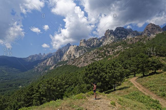 Female hiker in Aiguilles de Bavella massif