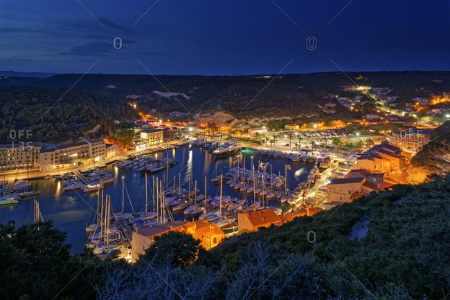 July 8, 2019: France- Corse-du-Sud- Bonifacio- Illuminated harbor of coastal town at night