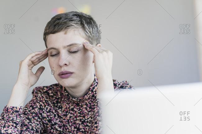 Portrait of businesswoman having headaches