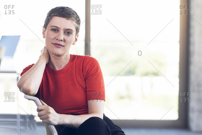 Portrait of confident businesswoman sitting on chair in office