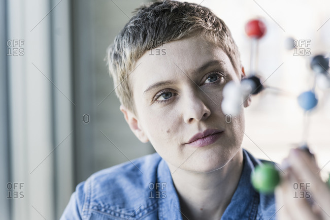 Woman looking at molecule model
