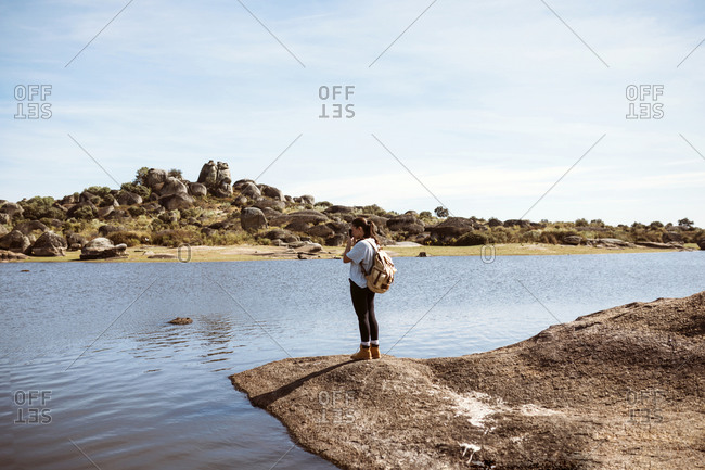 Female explorer taking a picture of a beautiful rocky landscape