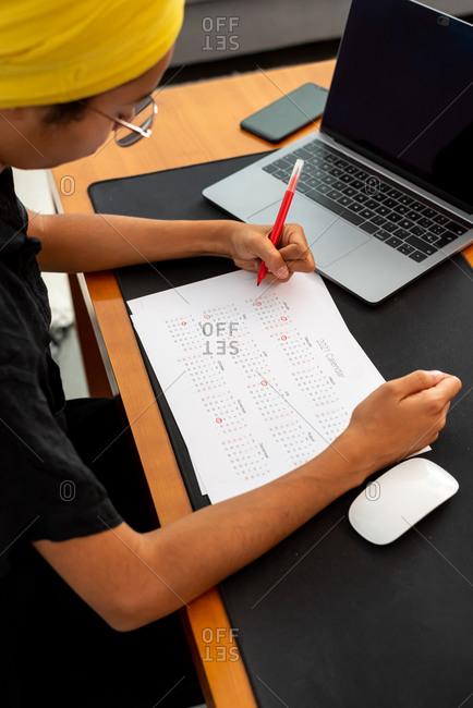 Woman marking 2021 US holidays on a calendar