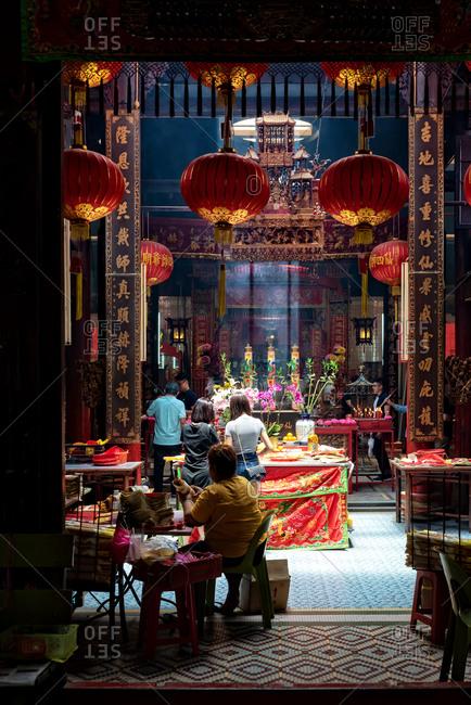 March 17, 22018: People praying in a Chinese temple of Kuala Lumpur, Malaysia