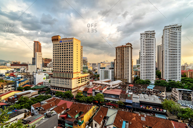 March 12, 2018: Skyline of traditional neighborhood and the financial buildings of Kuala Lumpur at sunset, Malaysia