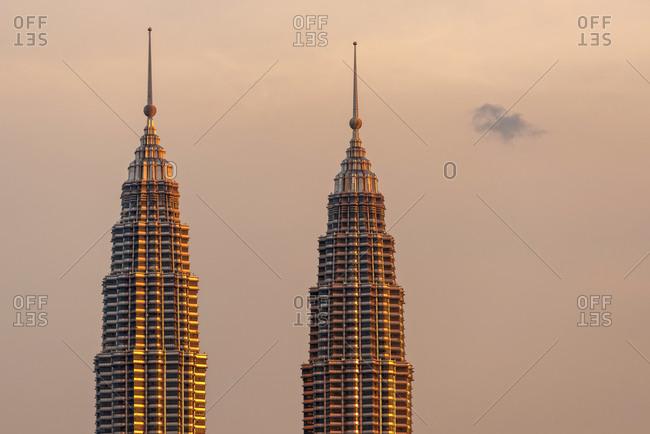March 18, 2018: Petronas Twin Towers at golden hour in Kuala Lumpur, Malaysia