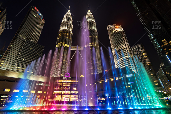 March 17, 2018: Low angle of Petronas Towers at night in Kuala Lumpur, Malaysia