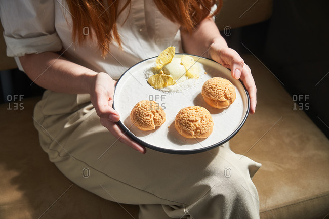 Woman holding a plate full of cookies