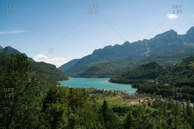 Big blue lake in Pyrenees surrounded by mountains