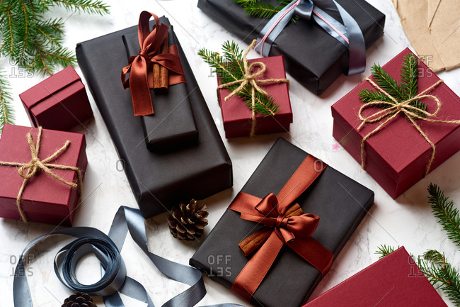 Top view of wrapped and decorated gifts and boxes with presents on marble background