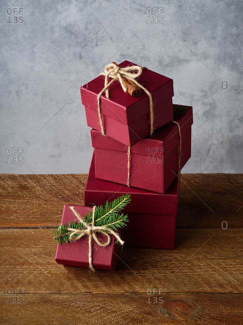 Red boxes with presents on wooden background