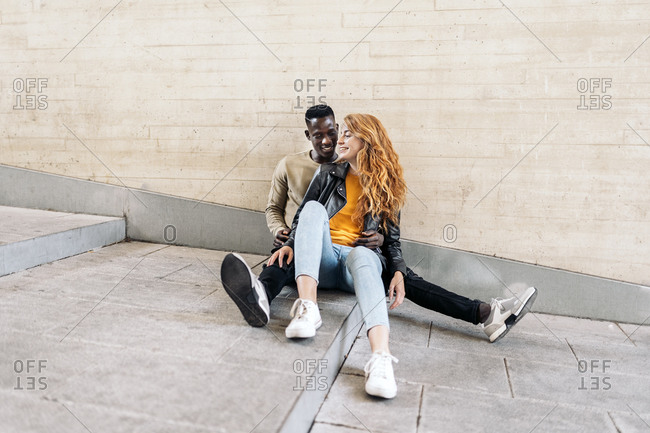 Multiethnic young couple having romantic moments together in the city