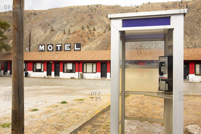 Old abandoned motel with telephone booth outside of Spenses Bridge in British Columbia, Canada
