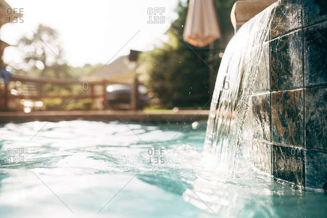 Water flowing from hot tub into a swimming pool