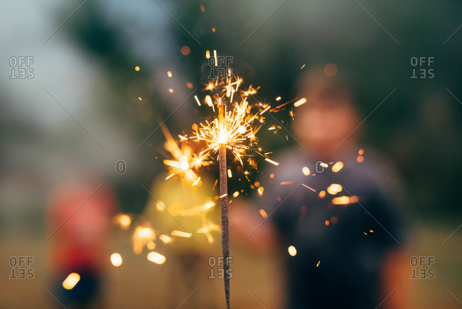 Close up of a sparkler burning on the 4th of July