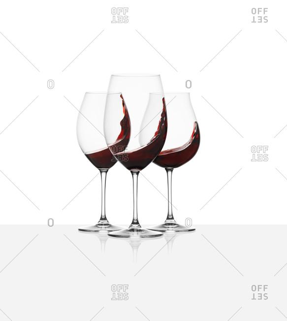 Three wine glass with wine swirls