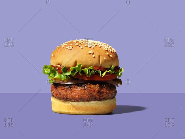 Meatless burger on purple background