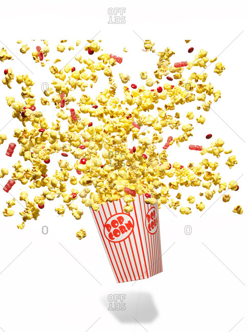 Popcorn and candy spilling out of popcorn box