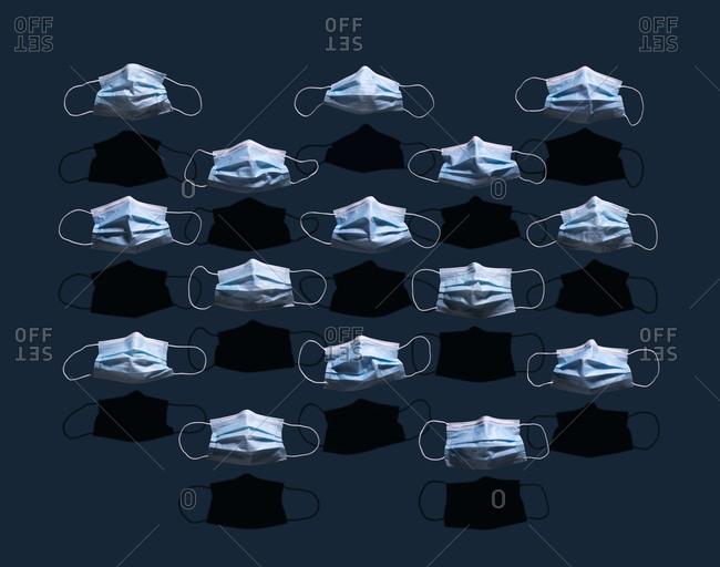 Still life arrangement of surgical masks