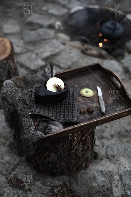 Making apple tea outside on open fire